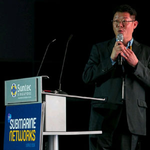 Scott Jang speaking at Submarine Networks World