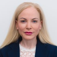 Nina Cummins speaking at Telecoms World Middle East
