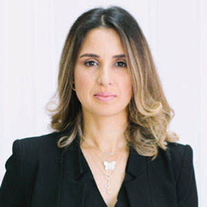 Dounia Fadi speaking at PropIT Middle East